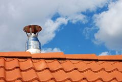 Roof and Sky. Red roof with chimney against the cloudy sky Stock Photos