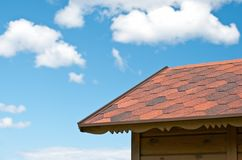 Roof and the sky with clouds Stock Photo