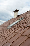 Roof with skylight, natural red tile and chimney Stock Image