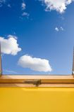 Roof skylight window and bue sky with white clouds. Roof skylight window and blue sky with white clouds. Welcome spring and open windows stock photo