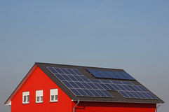 Roof with solar cells. New house with solar cells on the roof Royalty Free Stock Photo
