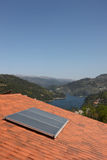 Roof with a solar panel Stock Photo