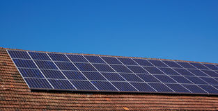 Roof with solar panels stock image