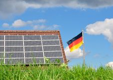 Roof with solar panels and German flag Stock Photography