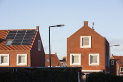 Roof with solar panels in a residential district Royalty Free Stock Photos
