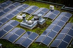 Roof with solar panels stock images