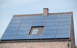 Roof and solar panels. Waiting for the sunlight Royalty Free Stock Photography