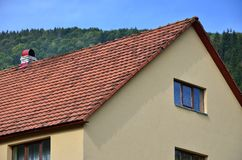 The roof of this square ceramic tile is red. The old type of roof covering in rich houses of the 19th centur. Y Stock Photos