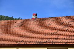 The roof of this square ceramic tile is red. The old type of roof covering in rich houses of the 19th centur royalty free stock photo