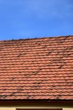 The roof of this square ceramic tile is red. The old type of roof covering in rich houses of the 19th centur stock photos