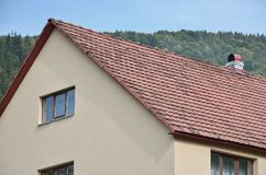 The roof of this square ceramic tile is red. The old type of roof covering in rich houses of the 19th century royalty free stock image