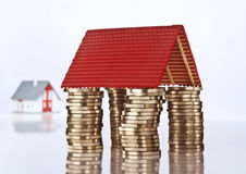 Roof on stacked coins Stock Photo