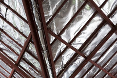 Roof with steel beam and silver foil insulation heat on ceiling Stock Photo