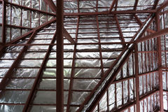 Roof with steel beam and silver foil insulation heat on ceiling Stock Image