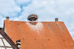 Roof with Storks Nest Stock Images