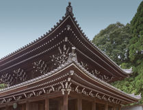 Roof structure of shrine at Chion-in Buddhist temple. Kyoto, Japan - September 16, 2016: Wooden roof structure of shrine at Chion-in Buddhist temple. Some trees royalty free stock images