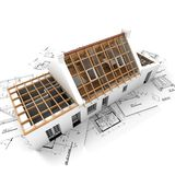 Roof structure on top of blueprints Stock Photography