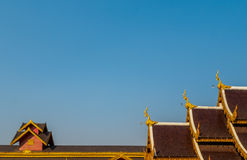 Roof Style of Thai Temple on Blue Sky Background Royalty Free Stock Image