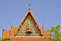 Roof style of Thai temple with gable apex on the top with blue s Royalty Free Stock Photos
