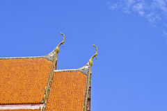 Roof style of Thai temple with gable apex on the top with blue s Stock Images