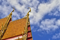 Roof style of Thai temple with gable apex on the top with blue s Royalty Free Stock Images