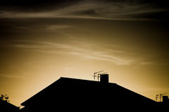 Roof in the sunset. Roof with antennas at the sunset Stock Photo