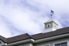 Roof surface,. House with a loft with sky as background Stock Photos