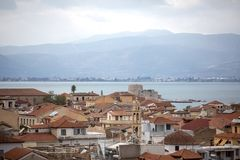 Panoramic view on Bourtzi castle and Nafplion from the fortress of Palamidi, Greece - Immagine. Roof and surrounding views of stock images