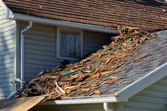 Roof Tear Off. Shingles on house roof being torn off Royalty Free Stock Photography