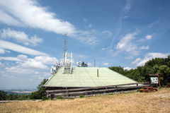 Roof with telecommunications antennas Stock Photography