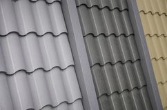 Roof templates from metal tile. Several roof cover pieces.  stock photography