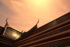 Roof of temple. Architecture roof of temple in Thai style at sundown Royalty Free Stock Image