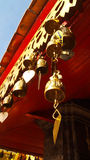 Roof temple bell. Golden bell on the temple's fascia Royalty Free Stock Photos