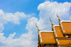 Roof temple in Thailand with blue sky Royalty Free Stock Photos