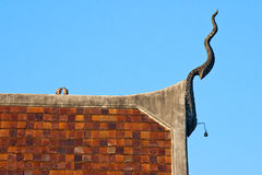 Roof of temple in thailand. Roof of temple with gable apex, dove in blue sky Stock Photography
