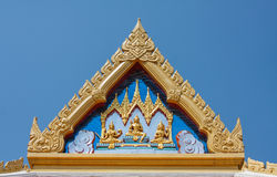 Roof temple, Thailand. Roof temple reliefs very well defined. Image on blue sky. Buddhist temple stock photos