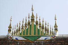 Golden roof of Unesco temple Wat Xieng Thong,Luang Prabang, Laos Stock Photo