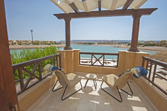 Roof terrace balcony with sun loungers in luxury apartment. Roof terrace furniture of a luxury villa in tropical resort with sun loungers and sea view royalty free stock photography
