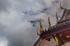 The roof of the Thai temple, along with the gable at the top of the church with a sky backdrop. Suitable for making background images stock photography