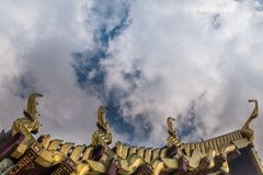 The roof of the Thai temple, along with the gable at the top of the church with a sky backdrop. Suitable for making background images royalty free stock photo