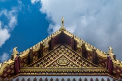 The roof of the Thai temple, along with the gable at the top of the church with a sky backdrop. Suitable for making background images royalty free stock images