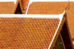 The roof of Thai temples in Bangkok. Orange pearls reflect the sun, the roof of Thai temples in Bangkok, Thailand, overlapping each other Royalty Free Stock Images