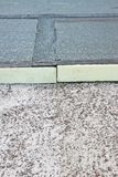 Roof thermal insulation with polystyrene panels covered with waterproof membrane under a concrete screed - Image with copy space.  stock photography