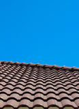 Roof tile with blue sky background vertical view. On shiny day Royalty Free Stock Images