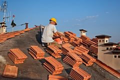 Roof tile installation royalty free stock photography