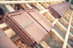 roof tile packs at house construction site. Roof under construction with modern tiles Royalty Free Stock Photography