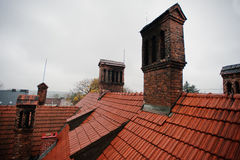Roof tile pattern with brick chimney at old hotic mansion Stock Photos