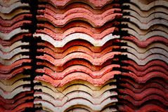 Roof tile stack. Building under re-construction demolished roof tile before Stock Photos