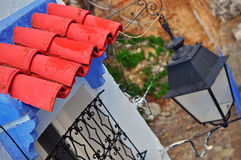 Roof tile and street lantern. Chefchaouen, Morocco stock photo