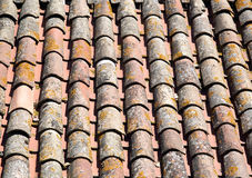 Roof of tiles. Roof of ancient tiles of terracotta of one of the housings of Cracassonne's Citadel Stock Photo